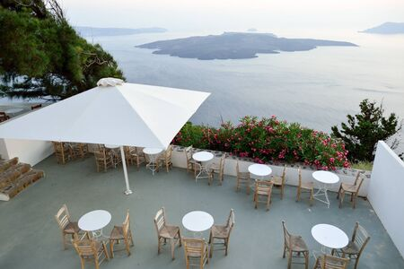 SANTORINI, GREECE - AUGUST 07, 2015: open air restaurant on Santorini island. The traditional architecture of Santorini is similar to that of the other Cyclades, with low-lying cubical houses Editorial