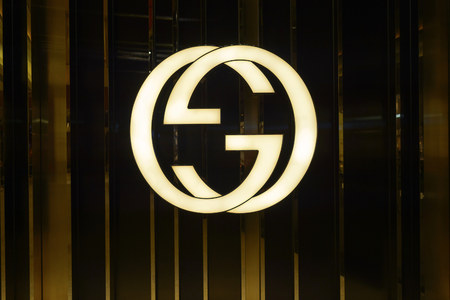 HONG KONG - OCTOBER 25, 2015: Gucci logo. Gucci is an Italian fashion and leather goods brand, part of the Gucci Group, which is owned by the French holding company Kering