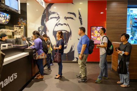 HONG KONG - OCTOBER 25, 2015: interior of McDonald's restaurant. McDonald's primarily sells hamburgers, cheeseburgers, chicken, french fries, breakfast items, soft drinks, milkshakes, and desserts