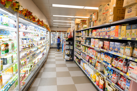 HONG KONG - JUNE 03, 2015: interior of the food supermarket.  Supermarkets in Hong Kong are strong in processed, chilled and frozen, canned and fresh foods