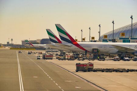 DUBAI, UAE - NOVEMBER 16, 2015: Boeing 777-300 docked in Dubai airport. Dubai International Airport is an international airport serving Dubai. It is a major airline hub in the Middle East, and is the main airport of Dubai.