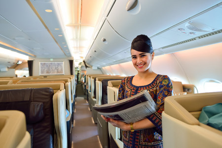SINGAPORE - NOVEMBER 10, 2015: Singapore Airlines crew member on board of Airbus A380. Singapore Airlines Limited is the flag carrier of Singapore which operates from its hub at Changi Airport