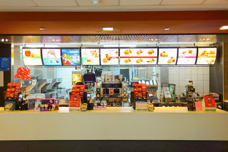 SHENZHEN, CHINA - MAY 25, 2015:  interior of McDonald's restaurant. McDonald's is the world's largest chain of hamburger fast food restaurants, founded in the United States.