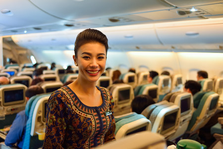 SINGAPORE - NOVEMBER 03, 2015: Singapore Airlines crew member on board of Airbus A380. Singapore Airlines Limited is the flag carrier of Singapore which operates from its hub at Changi Airport
