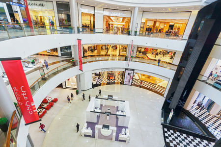 DUBAI - OCTOBER 15, 2014: interior of the Dubai Mall. The Dubai Mall located in Dubai, it is part of the 20-billion-dollar Downtown Dubai complex, and includes 1,200 shops. Editorial