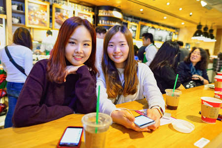 HONG KONG - DECEMBER 25, 2015: customers of Starbucks cafe. Starbucks Corporation is an American global coffee company and coffeehouse chain based in Seattle, Washington