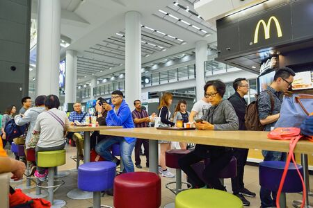 HONG KONG - NOVEMBER 15, 2015: people in the McDonald's restaurant. McDonald's primarily sells hamburgers, cheeseburgers, chicken, french fries, breakfast items, soft drinks, milkshakes, and desserts