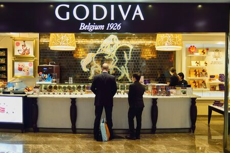 HONG KONG - MAY 5, 2015: interior of Godiva store in the IFC Mall. IFC Mall is a 800,000 sq ft, 4-storey shopping mall, with many luxury retail brands and wide variety of restaurants.