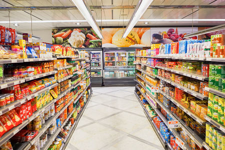 GENEVA, SWITZERLAND - SEPTEMBER 19, 2015: interior of Migros supermarket. Migros is Switzerland's largest retail company, its largest supermarket chain and largest employer Publikacyjne