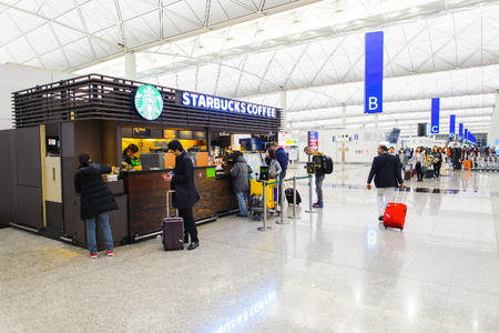 HONG KONG - FEBRUARY 04, 2015: Starbucks cafe in Hong Kong Airport. Starbucks is the largest coffeehouse company in the world, with more then 23000 stores
