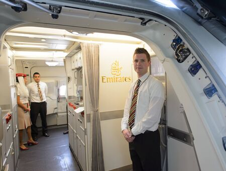 BANGKOK, THAILAND - MARCH 31, 2015: Emirates crew member meet passengers on second floor of A380. Emirates is one of two flag carriers of the United Arab Emirates along with Etihad Airways and is based in Dubai. Editorial