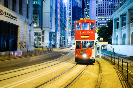 HONG KONG - JUNE 03, 2015: double-decker tram on street of HK. Hong Kong Tramways is a tram system in Hong Kong, being one of the earliest forms of public transport in the metropolis. Owned and operated by Veolia Transport Editorial