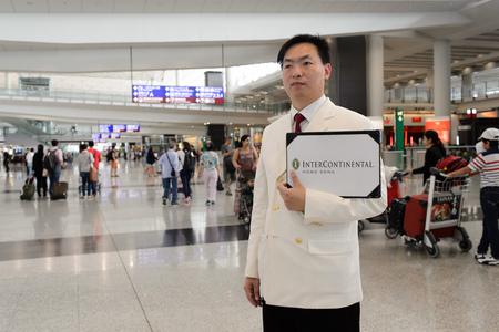 HONG KONG - JUNE 04, 2015: hotel staff meet passenger. Hong Kong International Airport is the main airport in Hong Kong. It is located on the island of Chek Lap Kok