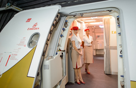 HONG KONG - JUNE 18, 2015: Emirates crew member meet passengers on second floor of A380. Emirates is one of two flag carriers of the United Arab Emirates along with Etihad Airways and is based in Dubai. 報道画像