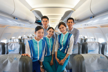 BANGKOK, THAILAND - NOV 11: Bangkok Airways crew members on November 11, 2014. Bangkok Airways is a regional airline based in Bangkok. Its main base is Suvarnabhumi Airport, Bangkok Editorial