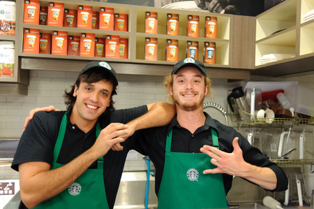 LOS ANGELES - APRIL 14: barmen in Starbucks Cafe on April 14, 2011 in Los Angeles, USA. Starbucks is the largest coffeehouse company in the world, with 23,187 stores Editorial