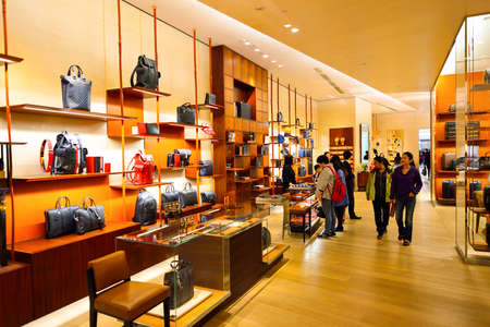 HONG KONG - DECEMBER 25, 2015: inside the Louis Vuitton store. Louis Vuitton is a French fashion house, one of the world's leading international fashion houses Editorial