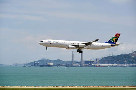 HONG KONG - JUNE 04, 2015: South African Airways aircraft landing at Hong Kong airport. South African Airways (SAA) is the national flag carrier and largest airline of South Africa Editorial