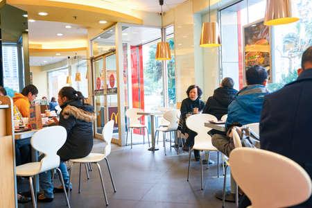 MACAO - FEBRUARY 17, 2016: inside of McDonalds restaurant. McDonalds primarily sells hamburgers, cheeseburgers, chicken, french fries, breakfast items, soft drinks, milkshakes, and desserts Editorial