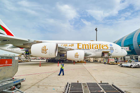 DUBAI, UAE - JUNE 23, 2015: Airbus A380 docked in Dubai airport. Dubai International Airport is an international airport serving Dubai. It is a major airline hub in the Middle East, and is the main airport of Dubai.