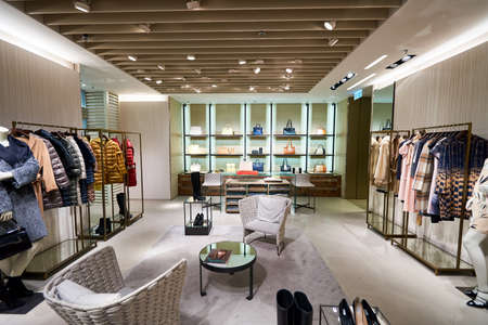 HONG KONG - JANUARY 26, 2016: inside of Max Mara store at Elements Shopping Mall. Max Mara is a luxury Italian fashion house belonging to the group of companies under the Max Mara Fashion Group holding.