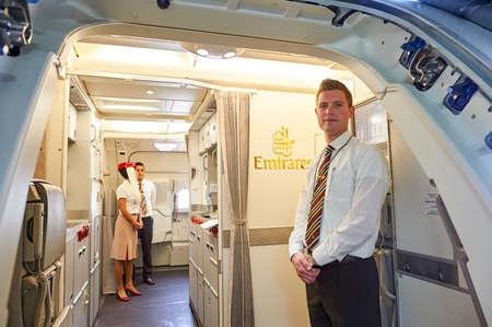 BANGKOK, THAILAND - MARCH 31, 2015: Emirates crew member meet passengers on second floor of A380. Emirates is one of two flag carriers of the United Arab Emirates along with Etihad Airways and is based in Dubai.