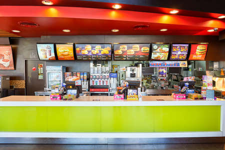 PATTAYA, THAILAND - FEBRUARY 21, 2016: inside of McDonald's restaurant. McDonald's primarily sells hamburgers, cheeseburgers, chicken, french fries, breakfast items, soft drinks, milkshakes, and desserts