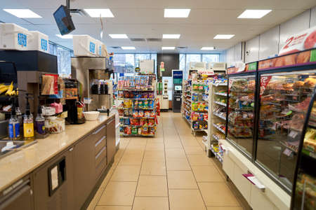 NEW YORK - CIRCA MARCH 2016: inside of 7-Eleven shop. 7-Eleven (7-11) is an international chain of convenience stores, headquartered in the American city of Dallas, Texas. Stock Photo - 62961186
