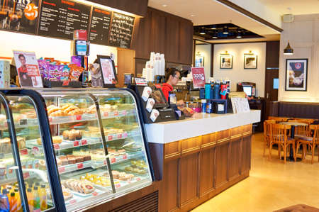 HONG KONG - JUNE 04, 2015: Pacific Coffee cafe interior. Pacific Coffee Company is a Pacific Northwest U.S.- style coffee shop group originating from Hong Kong, with a few outlets in China, Singapore and Malaysia