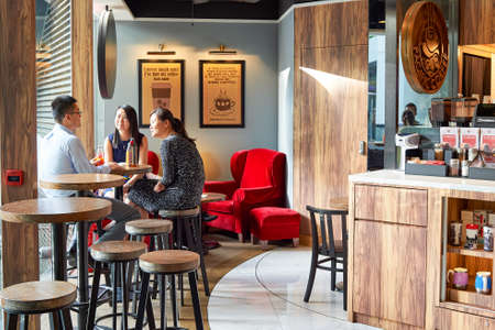 HONG KONG - JUNE 03, 2015: Pacific Coffee cafe interior. Pacific Coffee Company is a Pacific Northwest U.S.- style coffee shop group originating from Hong Kong, with a few outlets in China, Singapore and Malaysia