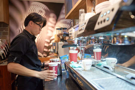 SHENZHEN, CHINA - CIRCA MAY, 2016: barista in Costa Coffee. Costa Coffee is a British multinational coffeehouse company. It is the second largest coffeehouse chain in the world behind Starbucks.