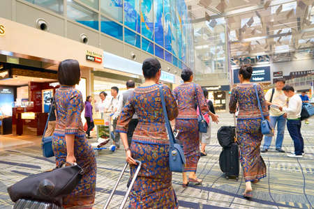 SINGAPORE - CIRCA AUGUST, 2016: Singapore Airlines crew members at Changi Aiport. Changi Airport is the primary civilian airport for Singapore. Editorial