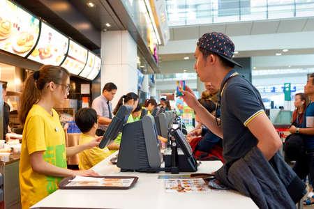 HONG KONG - CIRCA NOVEMBER, 2016: counter service in a McDonalds restaurant in Hong Kong. McDonalds, or simply McD, is an American hamburger and fast food restaurant chain.