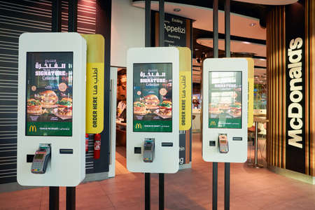 DUBAI, UAE - CIRCA NOVEMBER, 2016: Mcdonalds ordering kiosks at Dubai International Airport. McDonalds is an American hamburger and fast food restaurant chain. Editorial
