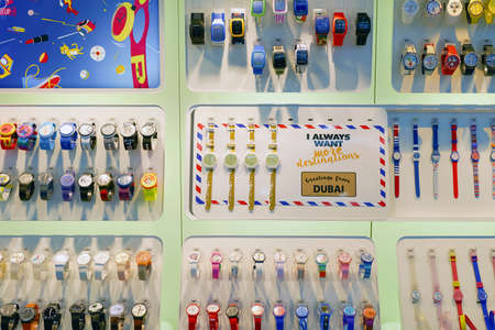 DUBAI, UAE - CIRCA NOVEMBER, 2016: Swatch watches in a store at Dubai International Airport. Swatch is a Swiss watchmaker founded in 1983 by Nicolas Hayek