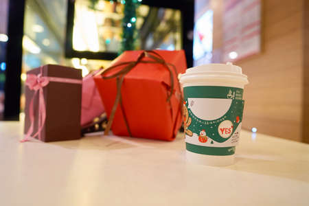 SHENZHEN, CHINA - CIRCA DECEMBER, 2016: McDonalds holday cup at McCafe in Shenzhen. McCafe is a coffee-house-style food and drink chain, owned by McDonalds.
