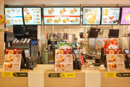SHENZHEN, CHINA - CIRCA DECEMBER, 2016:  counter service in a McDonalds restaurant. McDonalds is an American hamburger and fast food restaurant chain.