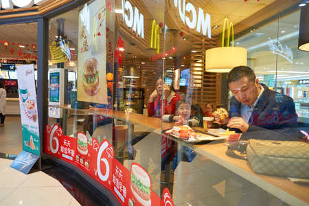 SHENZHEN, CHINA - CIRCA JANUARY, 2017: people eat at McDonalds restaurant in ShenZhen. McDonalds is an American hamburger and fast food restaurant chain.