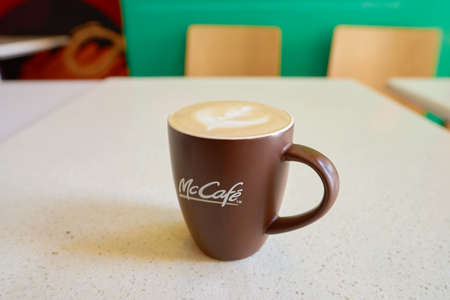 SHENZHEN, CHINA - CIRCA JANUARY, 2017: close up shot of a cup at McCafe. McCafe is a coffee-house-style food and drink chain, owned by McDonalds.