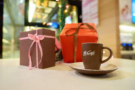 SHENZHEN, CHINA - CIRCA DECEMBER, 2016: cup with logo of McCafe. McCafe is a coffee-house-style food and drink chain, owned by McDonalds.