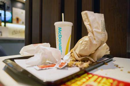 SHENZHEN, CHINA - CIRCA DECEMBER, 2016: left food tray at McDonalds restaurant. McDonalds is an American hamburger and fast food restaurant chain.