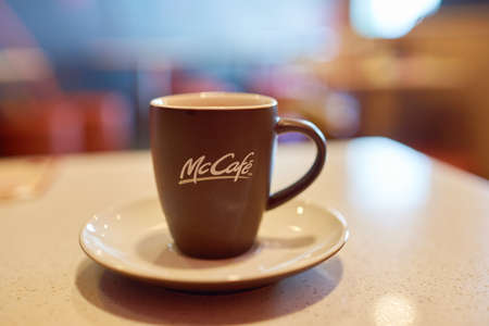 SHENZHEN, CHINA - CIRCA DECEMBER, 2016: close up shot of a cup at McCafe. McCafe is a coffee-house-style food and drink chain, owned by McDonalds. Editorial