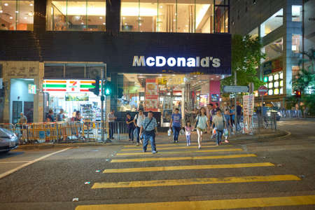 HONG KONG - OCTOBER 25, 2015: McDonalds restaurant and 7-eleven store in Kennedy Town. Kennedy Town is at the western end of Sai Wan on Hong Kong Island Editorial