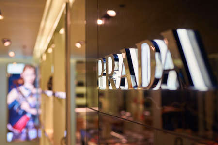 SINGAPORE - CIRCA SEPTEMBER, 2016: close up shot of Prada sign at Singapore Changi Airport.