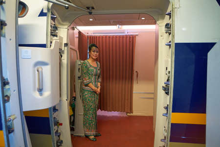 SINGAPORE - CIRCA AUGUST, 2016: crew member of Singapore Airlines meet passengers.