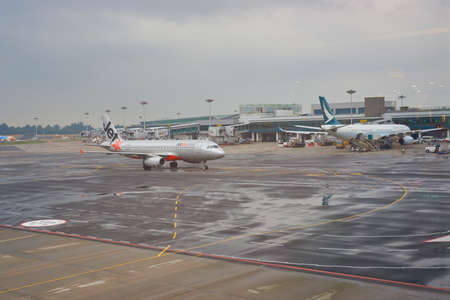 SINGAPORE - CIRCA SEPTEMBER, 2016: Jetstar aircraft at Changi Airport. Jetstar is an Australian low-cost airline headquartered in Melbourne.