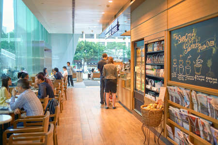HONG KONG - MAY 05, 2015: Starbucks coffee house in Hong Kong. Starbucks Corporation is an American coffee company and coffeehouse chain.