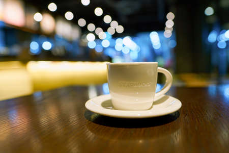 SEOUL, SOUTH KOREA - CIRCA MAY, 2017: a cup of coffee on a table in Starbucks. Starbucks Corporation is an American coffee company and coffeehouse chain.
