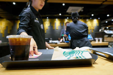 SEOUL, SOUTH KOREA - CIRCA MAY, 2017: coffee served on a tray in Starbucks. Starbucks Corporation is an American coffee company and coffeehouse chain.