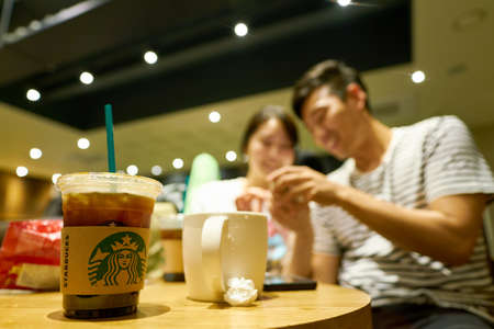 SEOUL, SOUTH KOREA - CIRCA MAY, 2017: close up shot of a cup Starbucks in Seoul. Starbucks Corporation is an American coffee company and coffeehouse chain.